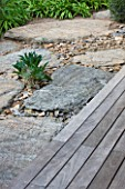 DESIGNER: JEAN-LAURENT FELIZIA  FRANCE: WOODEN DECKING  SLATE AND HUGE ROCKS