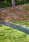 DESIGNER: JEAN-LAURENT FELIZIA  FRANCE: LAWN WITH SWIMMING POOL AND ROCK WALL