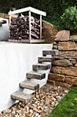 DESIGNER: JEAN-LAURENT FELIZIA  FRANCE: WOODEN STEPS UP A WHITE WALL UP TO A WOOD STORE