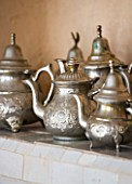 DESIGNERS ERIC OSSART AND ARNAUD MAURIERES  MOROCCO: AL HOSSOUN - TEAPOTS ON SHELF IN LIVING ROOM