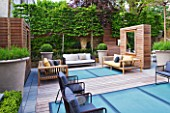 ROOF GARDEN BY STEPHEN WOODHAMS, LONDON: TERRACE/SEATING AREA WITH WOODEN BENCHES, BOX BALLS IN CONTAINERS, DECKING WITH FROSTED GLASS SKYLIGHTS, SCREEN, MIRROR, PLEACHED HORNBEAMS, DECKS, DECKING, DECKED