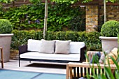 MODERN ROOF GARDEN BY STEPHEN WOODHAMS, LONDON: WOODEN BENCH/SEAT. DECK AND FROSTED GLASS SKYLIGHTS TO POOL BELOW. PLEACHED HORNBEAMS. CONTEMPORARY