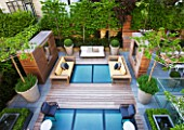 MODERN ROOF GARDEN BY STEPHEN WOODHAMS, LONDON: CEDARWOOD SCREEN, MIRROR, TABLE, CHAIRS, CLIPPED, TOPIARY, PLEACHED, HORNBEAMS, CONTEMPORARY, BOX BALLS IN CERAMIC CONTAINERS, CORNUS KOUSA, TERRACE, BALCONY, DECKING, DECKED, DECKS