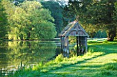 NARBOROUGH HALL GARDENS  NORFOLK: THE RECENTLY RESTORED  LISTED BOAT HOUSE ON THE BANKS OF THE RIVER NAR