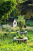DESIGNER ALISON HENRY - PRIVATE GARDEN, COTSWOLDS: MEADOW WITH DRYSTONE PLANTER TREE SEATS AND WENDY HOUSE - ENGLISH GARDEN, CLASSIC, COUNTRY
