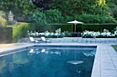 PRIVATE GARDEN, COTSWOLDS: DESIGNER ALISON HENRY - LAWN, SWIMMING POOL, TERRACE / PATIO - ROSE WINCHESTER CATHEDRAL, LAVENDER HIDCOTE.  FORMAL, WATER, CLASSIC,  ENGLISH,  GARDEN