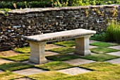 DESIGNER ALISON HENRY - PRIVATE GARDEN, COTSWOLDS: STONE SEAT / BENCH BY STONE WALL WITH CHEQUERBOARD GRASS SQUARES - ENGLISH GARDEN, CLASSIC, COUNTRY