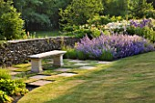 DESIGNER ALISON HENRY - PRIVATE GARDEN, COTSWOLDS: STONE SEAT / BENCH BY STONE WALL WITH CHEQUERBOARD GRASS SQUARES, BORDER OF NEPETA  - ENGLISH GARDEN, CLASSIC, COUNTRY