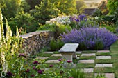 DESIGNER ALISON HENRY - PRIVATE GARDEN, COTSWOLDS: STONE SEAT / BENCH BY STONE WALL WITH CHEQUERBOARD GRASS SQUARES AND NEPETA - ENGLISH GARDEN, CLASSIC, COUNTRY