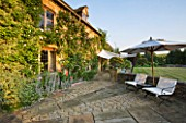 DESIGNER ALISON HENRY, PRIVATE GARDEN, COTSWOLDS - LAWN, STONE TERRACE / PATIO WITH SEATS AND CANVAS SAIL CANOPY - COUNTRY, GARDEN, SUMMER, CLASSIC, ENGLISH