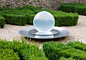 WHATLEY MANOR  WILTSHIRE: THE KNOT GARDEN WITH BOX BALLS AND A WATER FEATURE BY ALISON ARMOUR-WILSON