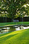 WHATLEY MANOR  WILTSHIRE: THE LOGGIA GARDEN WITH LAWN  POOL AND WATER FEATURE BY SIMON ALLISON