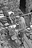 DIGNE LES BAINS  FRANCE: BLACK AND WHITE IMAGE STONE MASONS WORKING FOR ANDY GOLDSWORTHY