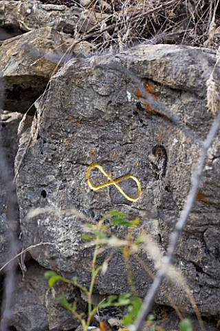 DIGNE_LES_BAINS__FRANCE_GOLD_INFINITY_SIGN_IN_ROCK_BY_HERMAN_DE_VRIES