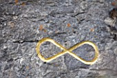 DIGNE-LES-BAINS  FRANCE: GOLD INFINITY SIGN IN ROCK BY HERMAN DE VRIES