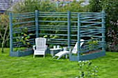 DESIGNER CLARE MATTHEWS: THE FRUIT AND VEGETABLE GARDEN IN DEVON. RAISED  BLUE PAINTED WOODEN BEDS AND ARBOUR WITH DECK CHAIRS