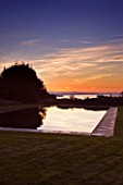 ARGENTARIO GARDEN  ITALY - DESIGNER: PAOLO PEJRONE  - BLACK SWIMMING POOL AT SUNSET