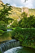 NINFA GARDEN, GIARDINI DI NINFA, ITALY: STREAM THROUGH GARDEN WITH WATERFALL AND STONE TOWER. ROMANTIC, STREAM, RIVER, FLOW, FLOWING, MOVEMENT, WALLS, OLD BUILDING, ROMANTIC