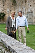 NINFA GARDEN, GIARDINI DI NINFA, ITALY: PROPERTY MANAGER LAURO MARCHETTI AND HIS WIFE WITH THEIR DOG