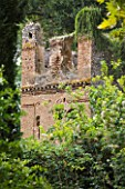 NINFA GARDEN, GIARDINI DI NINFA, ITALY: RUINED BUILDING IN THE GARDEN. WALL, ANCIENT MONUMENT, SUMMER, MEDITERRANEAN GARDEN, ITALIAN GARDEN