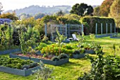 DESIGNER CLARE MATTHEWS: THE FRUIT AND VEGETABLE GARDEN IN DEVON. RAISED  BLUE PAINTED WOODEN BEDS AND ARBOUR