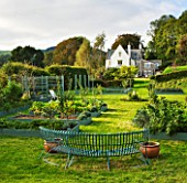 DESIGNER CLARE MATTHEWS: THE FRUIT AND VEGETABLE GARDEN IN DEVON. RAISED  BLUE PAINTED WOODEN BEDS AND ARBOUR  BLUE PAINTED METAL BENCH AND HOUSE