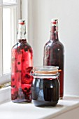DESIGNER: CLARE MATTHEWS: FRUIT GARDEN PROJECT - HOME GROWN PRESERVES IN GLASS BOTTLES AND A JAR