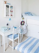 DESIGNER: JACKY HOBBS  LONDON: BLUE AND WHITE THEMED BOYS BEDROOM AT CHRISTMAS