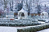 FORMAL TOWN GARDEN IN SNOW  OXFORD  WINTER: DESIGN BY LIZ NICHOLSON - SUMMERHOUSE AND GAZEBOS/ ARBOURS WITH LOW BOX EDGED BEDS