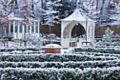 FORMAL TOWN GARDEN IN SNOW  OXFORD  WINTER: DESIGN BY LIZ NICHOLSON - SUMMERHOUSE AND GAZEBO/ ARBOUR WITH LOW BOX EDGED BEDS
