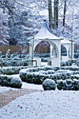 FORMAL TOWN GARDEN IN SNOW  OXFORD  WINTER: DESIGN BY LIZ NICHOLSON - GAZEBO/ ARBOUR WITH BOX HEDGING