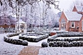FORMAL TOWN GARDEN IN SNOW  OXFORD  WINTER: DESIGN BY LIZ NICHOLSON - BOX HEDGING WITH HOUSE BEHIND