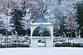 FORMAL TOWN GARDEN IN SNOW  OXFORD  WINTER: DESIGN BY LIZ NICHOLSON - ARBOUR/ GAZEBO  BOX HEGDING AND HORNBEAMS - CARPINUS BETULUS