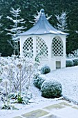 FORMAL TOWN GARDEN IN SNOW  OXFORD  WINTER: DESIGN BY LIZ NICHOLSON - ARBOUR/ GAZEBO  BOX HEGDING  HYDRANGEA ANNABELLE AND HORNBEAMS - CARPINUS BETULUS