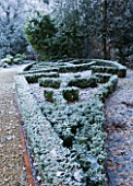 FORMAL TOWN GARDEN IN SNOW  OXFORD  WINTER: DESIGN BY LIZ NICHOLSON - BOX HEDGING IN THE SHAPE OF A LEAF BESIDE THE MAIN DRIVE