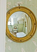 BRUERN COTTAGES  OXFORDSHIRE: CHRISTMAS - THE TWIN BEDROOM -  A CONVEX MIRROR ACTS AS A FISH-EYE LENS  GIVING A PICTURE OF THE ENTIRE BEDROOM