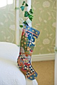 BRUERN COTTAGES  OXFORDSHIRE: CHRISTMAS - CHRISTMAS STOCKING AT THE END OF THE BED