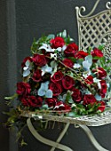 JUDITH BLACKLOCK: VALENTINES FLOWER ARRANGEMENT ON METAL CHAIR WITH ROSES  IVY BERRIES AND EUCALYPTUS