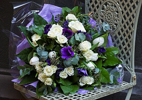 JUDITH_BLACKLOCK_FLOWER_ARRANGEMENT_ON_METAL_CHAIR_WITH_WHITE_ROSES__EUCALYPTUS_AND_ANEMONES