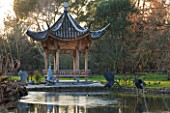 RHS GARDEN WISLEY  SURREY:  VIEW ACROSS THE LAKE AT SEVEN ACRES TO THE CHINESE PAGODA. WINTER  JANUARY.