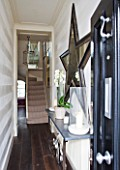 DESIGNER JANE CHURCHILL : NARROW HALLWAY HALLWAY LEADING TO DRAWING ROOM AND STAIRCASE