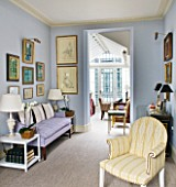 DESIGNER JANE CHURCHILL : THE DRAWING ROOM WITH LIGHT FILLED CONSERVATORY AT THE END