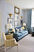 DESIGNER JANE CHURCHILL : THE DRAWING ROOM - LIMEWASHED WALLS  GOLD PAINTED WALL SCONCE