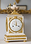 DESIGNER JANE CHURCHILL : ANTIQUE FRENCH CLOCK ABOVE FIREPLACE IN DRAWING ROOM