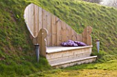 DESIGNER - CLARE MATTHEWS: WOODEN THRONE SEAT SET INTO HILLSIDE. SLOPE