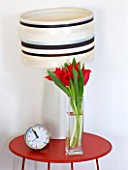 DESIGNER: KALLY ELLIS  LONDON: BEDSIDE TABLE WITH ALADDIN TULIPS