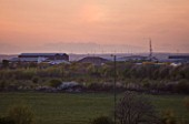 TEESSIDE  UNITED KINGDOM - PHOTO AT DUSK SHOWING WIND TURBINES IN THE DISTANCE