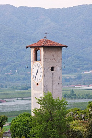 GARDEN_OF_PAOLO_PEJRONE__ITALY_VIEW_OF_THE_GARDEN_AND_CLOCK_TOWER__WITH_MOUNTAINS_BEHIND