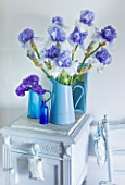 IRIS CAYEUX  FRANCE - BLUE ARRANGEMENT OF IRIS WISHFUL THINKING AND SMALL JUG OF PLEDGE ALLEGIANCE