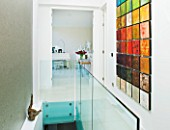 CAKE BOY HOUSE  LONDON: HALLWAY WITH ISABELLA KAY PAINTING  COMPRISING 50 MINI-CANVASES  WITH LIVING ROOM BEHIND